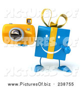 December 6th, 2015: Clipart of a 3d Happy Blue Gift Character Holding and Pointing to a Yellow Camera by Julos