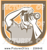 Vector Clipart of a Retro Male Photographer Taking Pictures in a Shield by Patrimonio